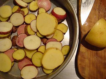 Potatoes sliced thin for Commando Style Roast Chicken